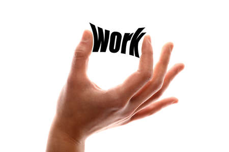 commitments: Color horizontal shot of a hand squeezing the word work. Stock Photo