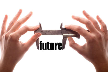 foresight: Color horizontal shot of two hands holding a caliper and measuring the word future.