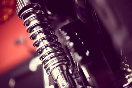 in shock: Color shot of a motorcycle shock absorber. Stock Photo