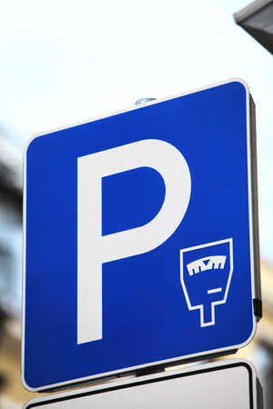 paid: Color image of a paid parking sign.