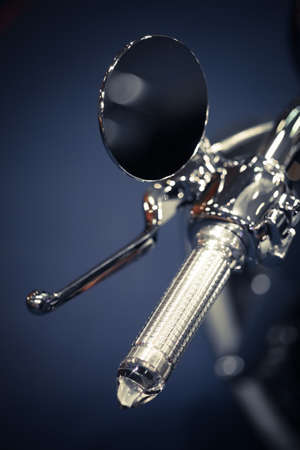 espejo: Close up shot with a motorcycle mirror on the handlebar.