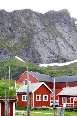 red mountain: Color image of some traditional houses in Reine, Lofoten Islands, Norway.