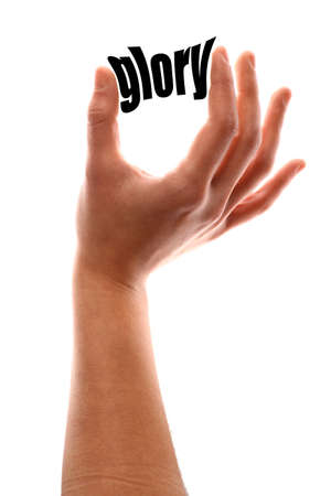 praise hands: Color vertical shot of a of a hand squeezing the word glory. Stock Photo