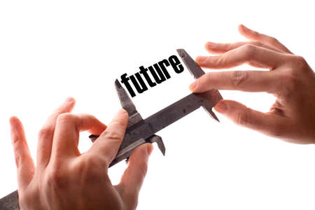 exact: Color horizontal shot of two hands holding a caliper and measuring the word future.