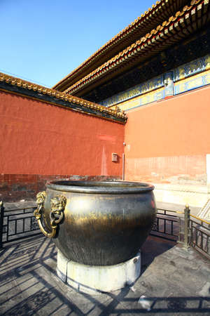 bronze bowl: Large bronze bowl to extinguish fire with image Chinese dragon statue in the Forbidden City, Beijing, China