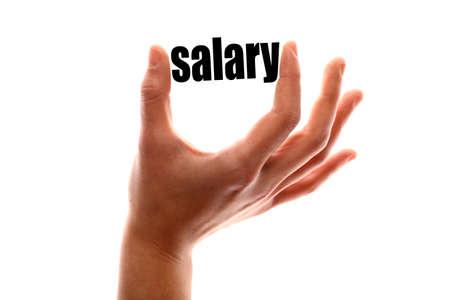 """remuneraciÓn: tiro horizontal de color de una de una mano apretando la palabra """"salario"""". Foto de archivo"""