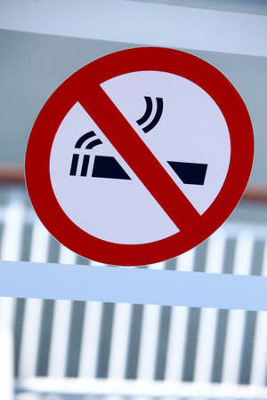 hazard sign: Color image of a Non Smoking sign on a window. Stock Photo