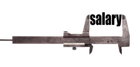 salary: Color horizontal shot of a caliper and measuring the word salary.