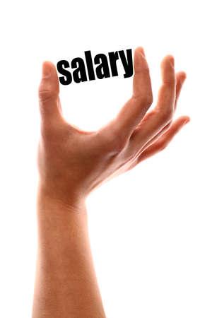 """remuneraciones: tiro vertical de color de una de una mano apretando la palabra """"salario""""."""