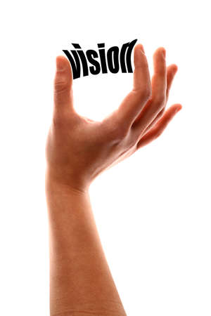 foresight: Color vertical shot of a of a hand squeezing the word vision.