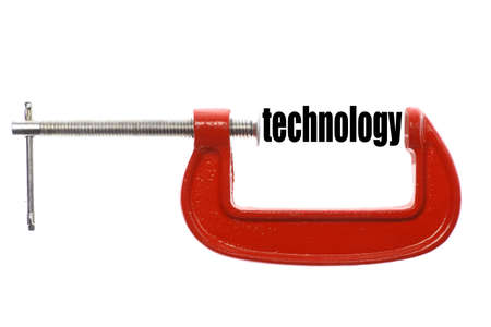 vice: The word technology is compressed with a vice. Stock Photo