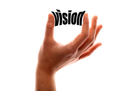aspirational: Color horizontal shot of a of a hand squeezing the word vision. Stock Photo