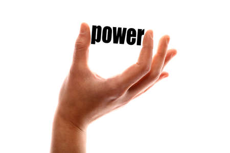 powerful creativity: Color horizontal shot of a of a hand squeezing the word power. Stock Photo