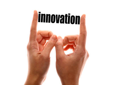 exact: Color horizontal shot of a of a hand squeezing the word innovation.