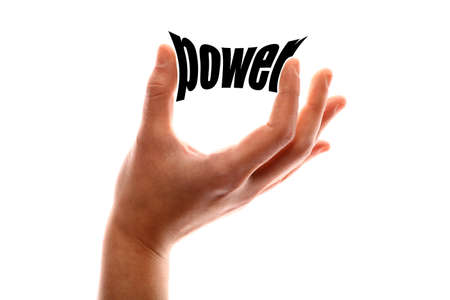 potency: Color horizontal shot of a of a hand squeezing the word power. Stock Photo