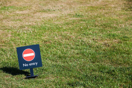 no entry: Color image of a No Entry sign on a meadow.