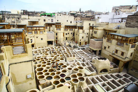 Fez, Morocco - August 20, 2015: Image of the tannery leather souk of weavers in Fez, Morocco, being renovated. The tannery souk of weavers is the most tourists visited part of Fez, historic city listed in UNESCO. Editorial