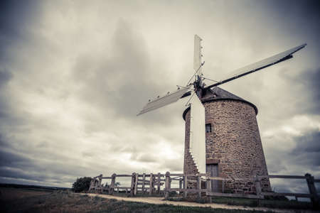 wood turning: Color image of an old wind mill. Stock Photo