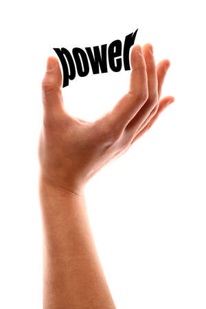 powerful creativity: Color vertical shot of a of a hand squeezing the word power.