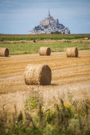 mont saint michel: Color image some hay rolls in front of Mont Saint Michel in Normandy, France. Editorial