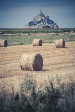 michel: Color image some hay rolls in front of Mont Saint Michel in Normandy, France. Editorial