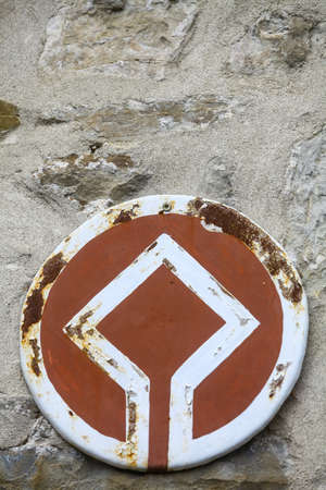 Color image of the UNESCO World Heritage site emblem on a wall.