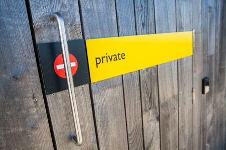 room door: Color image of a No Entry sign on a wooden door.