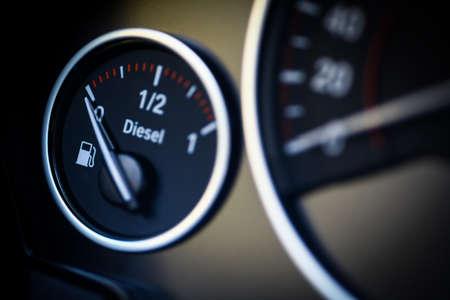 refuel: Close-up shot of a fuel gauge in a car.