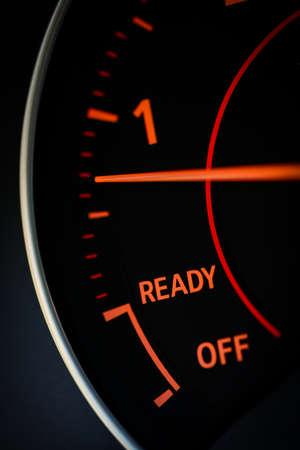 rev: Detail of a tachometer in a car.
