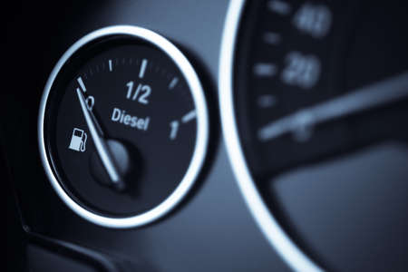 fuel economy: Close-up shot of a fuel gauge in a car.