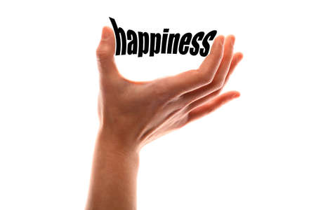 Color horizontal shot of a of a hand squeezing the word happiness.