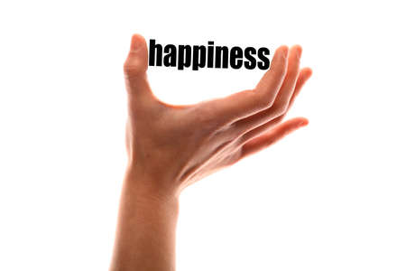 vivacity: Color horizontal shot of a of a hand squeezing the word happiness.
