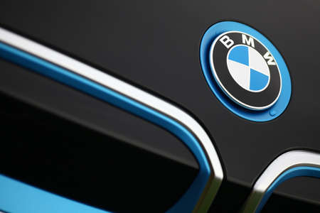 Bucharest, Romania - November 10, 2015: Detail of the vent of a BMW i3 logo on a car. BMW i3 is a five-door urban electric car developed by the German manufacturer BMW. Reklamní fotografie - 50729108