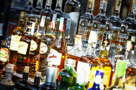 spirits: Bucharest, Romania - September 9, 2015: Several types of bottled alcohol are displayed on some shelves in a pub in Bucharest, Romania.