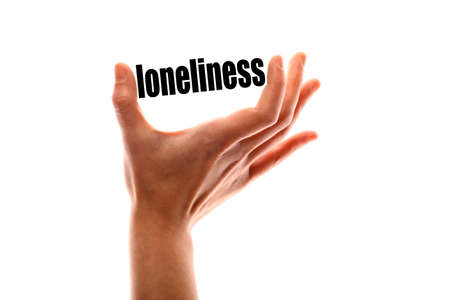 exact: Color horizontal shot of a of a hand squeezing the word loneliness. Stock Photo