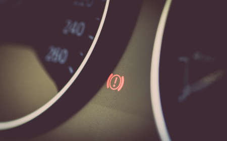 dashboard: Color image of a red warning image on the dashboard of a car.