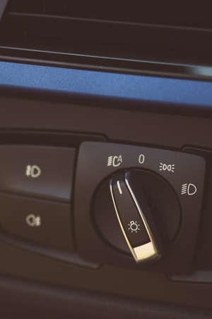 headlights: Color image of the headlights switch in a car. Stock Photo