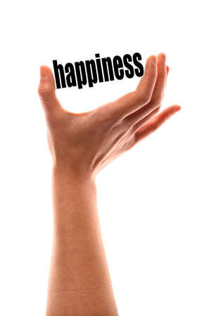 Color vertical shot of a of a hand squeezing the word happiness.