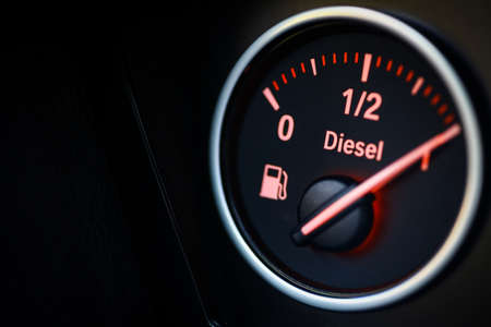 Close-up shot of a fuel gauge in a car.