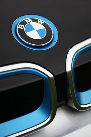 i3: Bucharest, Romania - November 10, 2015: Detail of the vent of a BMW i3 logo on a car. BMW i3 is a five-door urban electric car developed by the German manufacturer BMW.