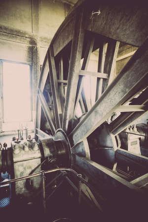 elevators: Color image of the elevators top wheel, in a coal mine.