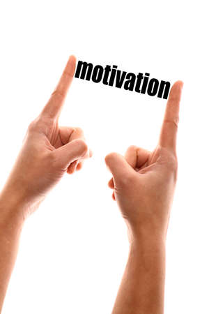 self improvement: Color vertical shot of a of a hand squeezing the word motivation. Stock Photo