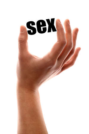 artistic nude: Color vertical shot of a hand squeezing the word sex. Stock Photo