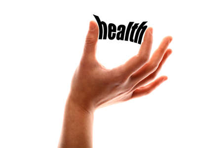 well being: Color horizontal shot of a of a hand squeezing the word health. Stock Photo