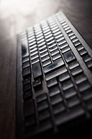 input devices: Close up shot of a backlit computer keyboard. Stock Photo
