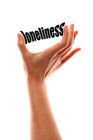 pain scale: Color vertical shot of a of a hand squeezing the word loneliness. Stock Photo