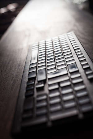 backlit keyboard: Close up shot of a backlit computer keyboard. Stock Photo