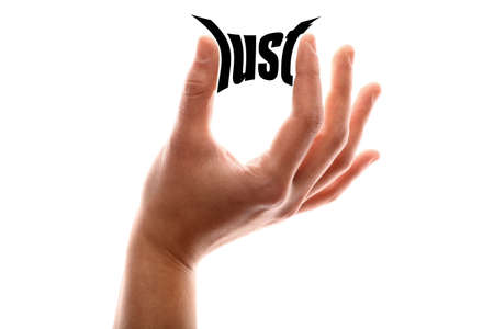 artistic nude: Color horizontal shot of a hand squeezing the word lust.
