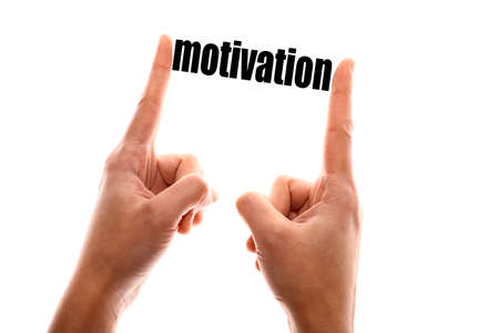 self improvement: Color horizontal shot of a of a hand squeezing the word motivation.