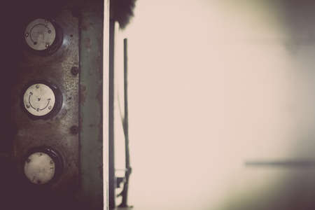 Color image of some buttons on a dirty old control panel. Stock Photo